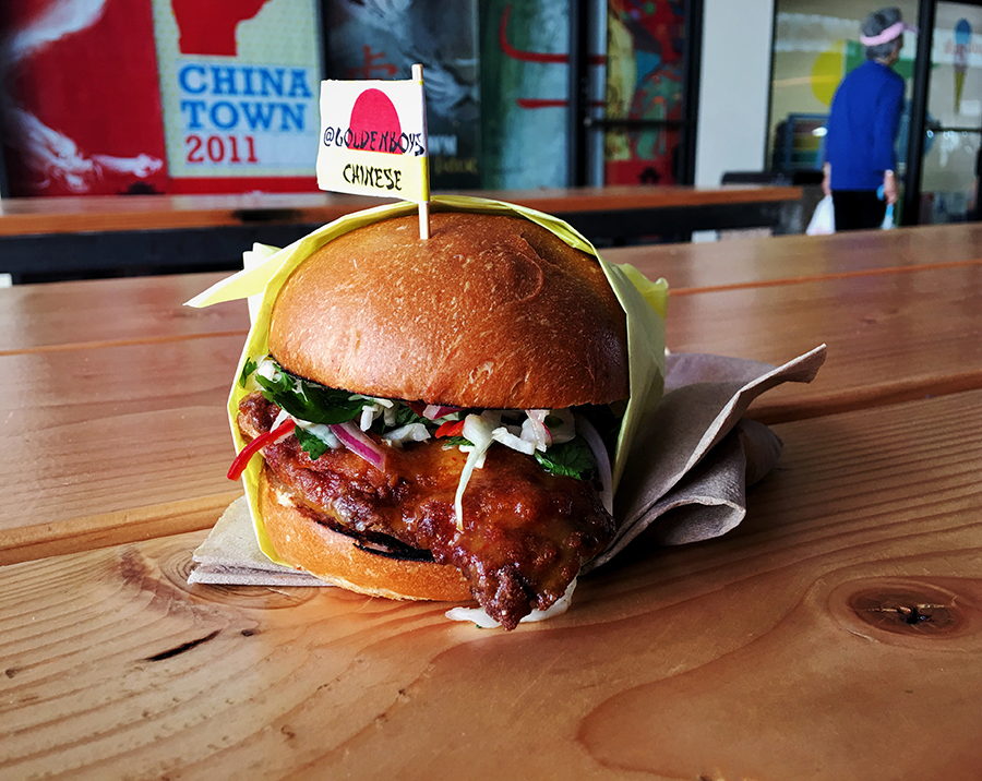 The epic fried orange chicken sandwich from Goldenboys Chinese pop-up on Thursdays at Unit 120 Photo by: Dana Benoit