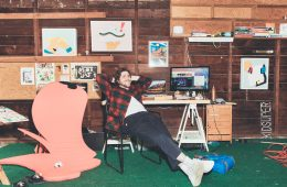 Jack Herzog lounging in his studio.