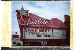 A polaroid of a swap meet sign in San Gabriel Valley.