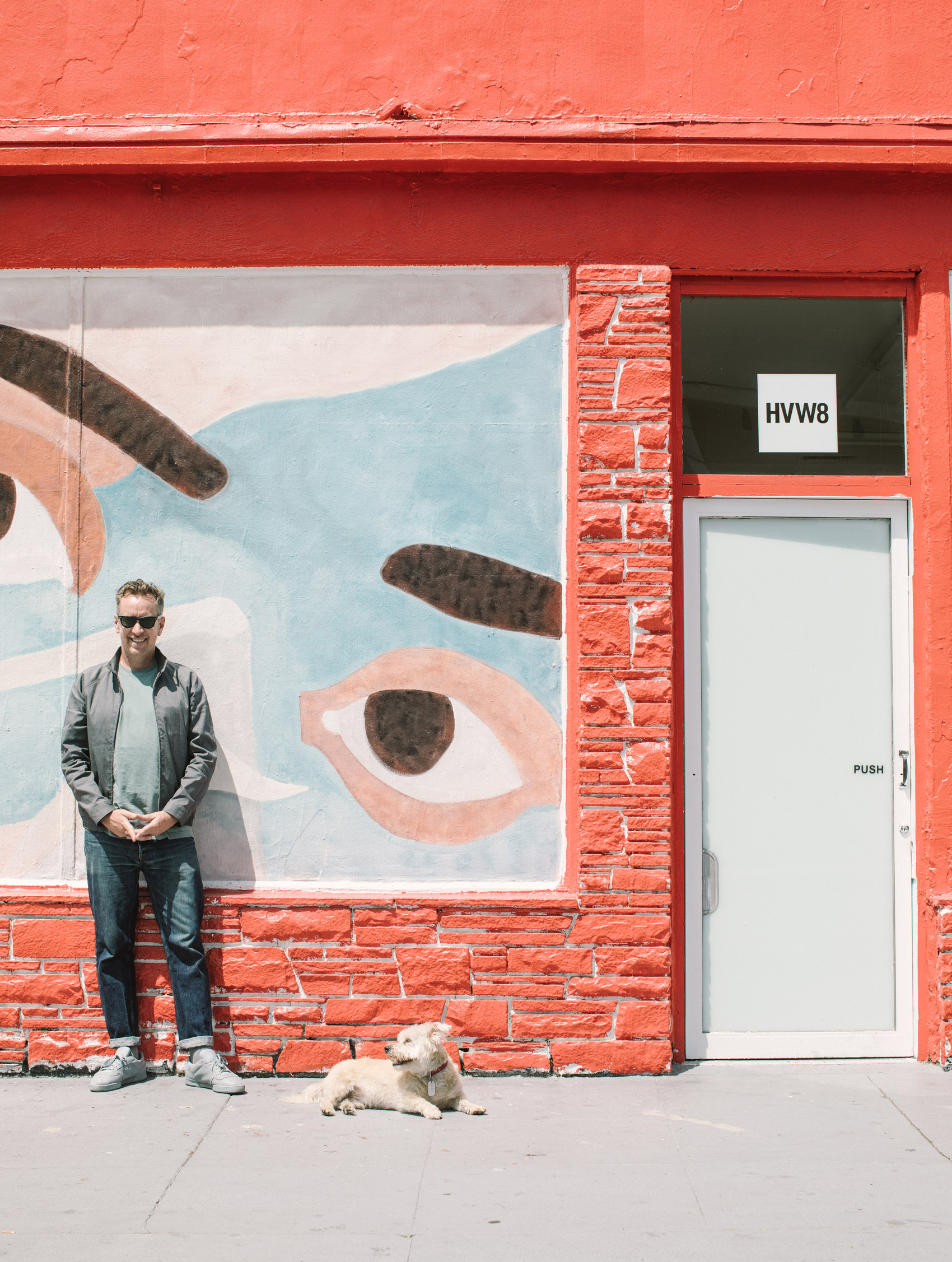 A photo of Tyler Gibney standing in front of his gallery HVW8.