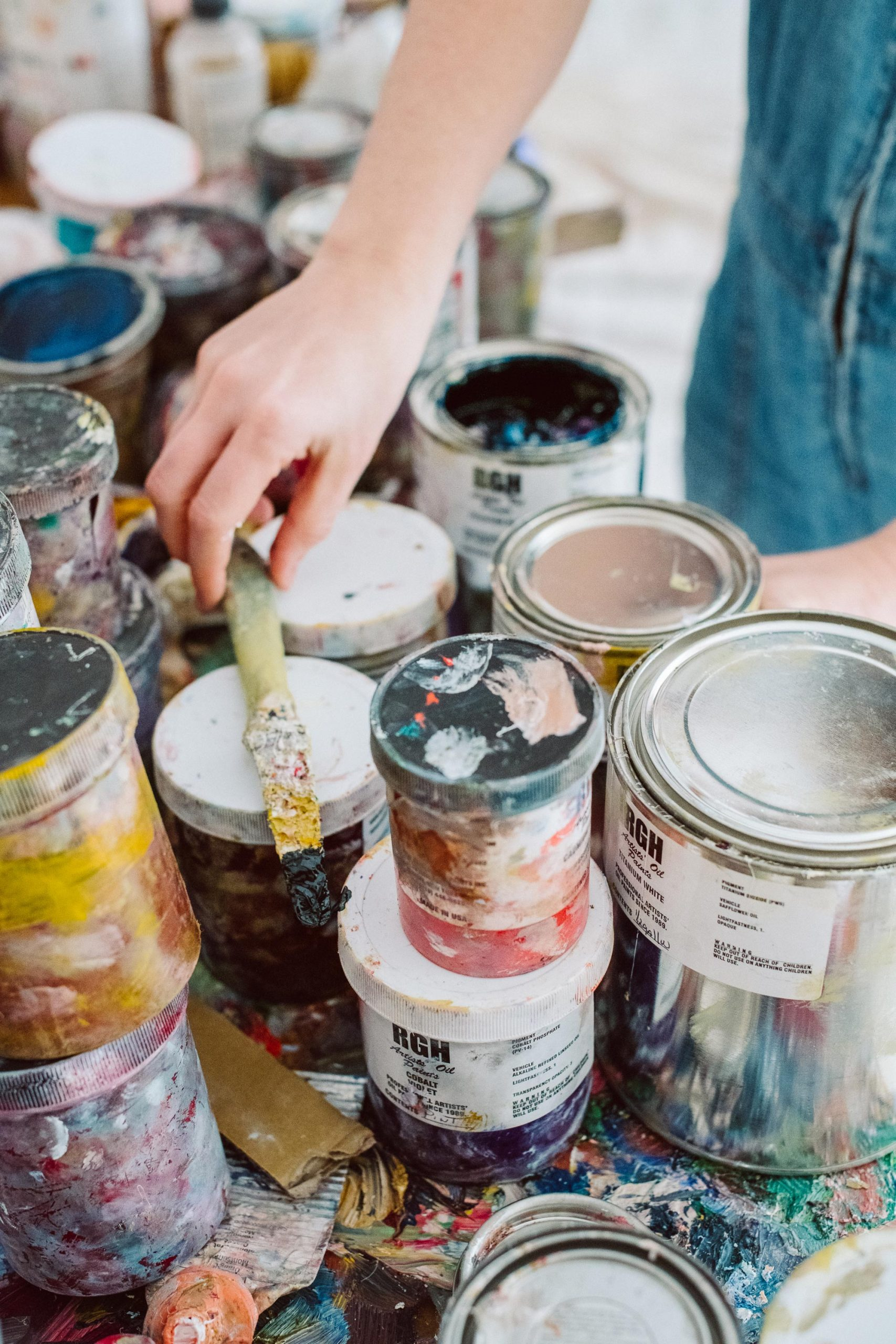 A table in Vanessa Prager's studio covered with small buckets of paint.