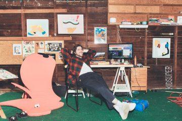Jack Herzog lounging in his studio.