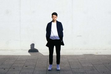 French DJ Zimmer standing in front of a white wall facing the camera.